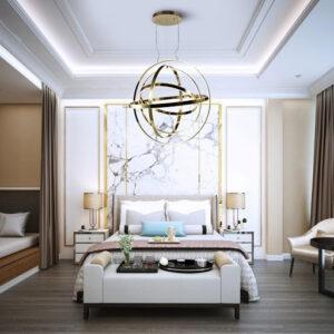 Sypialnia ze złotą, wiszącą lampą, która składa się z pierścieni